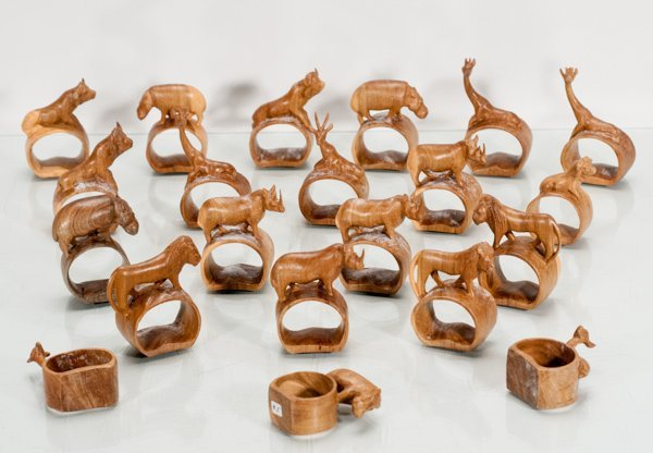 Twenty-One Wooden Carved Napkin Rings