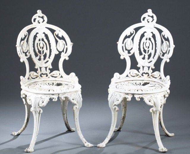 Pair of 20th c. White Painted Cast Iron Chairs.