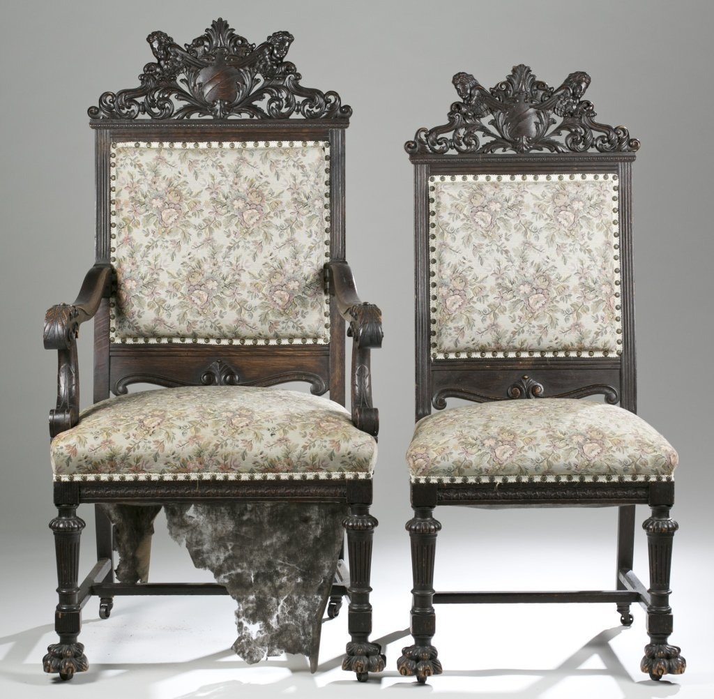 Eight Ornately Carved Jacobean Revival Chairs.