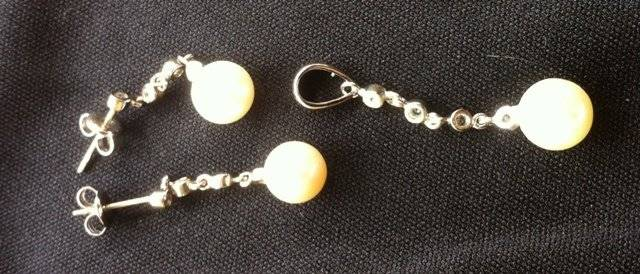Suite of Silver Mounted Pearl Jewellery,