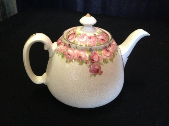 A  Royal Doulton English Rose Tea Pot,