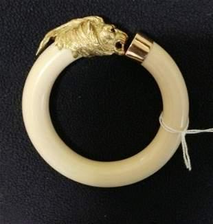 A Superb Diamond, Gold and Ivory Figural Bangle