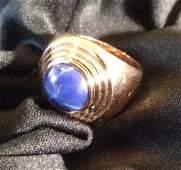 An 18 Carat Yellow Gold Star Sapphire Set Dress Ring