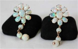 A Pair of Rose Gold Opal Mounted Earrings ,