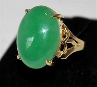 A Jade Mounted Gold Dress Ring ,