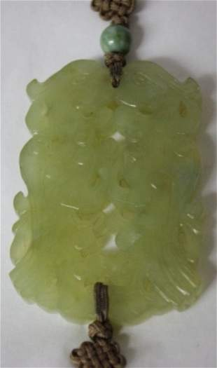 A Chinese Carved Nephrite Pendent ,
