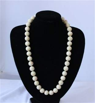 A Chinese Ivory Beaded Necklace