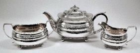 5: A George III silver three piece tea service, the squ