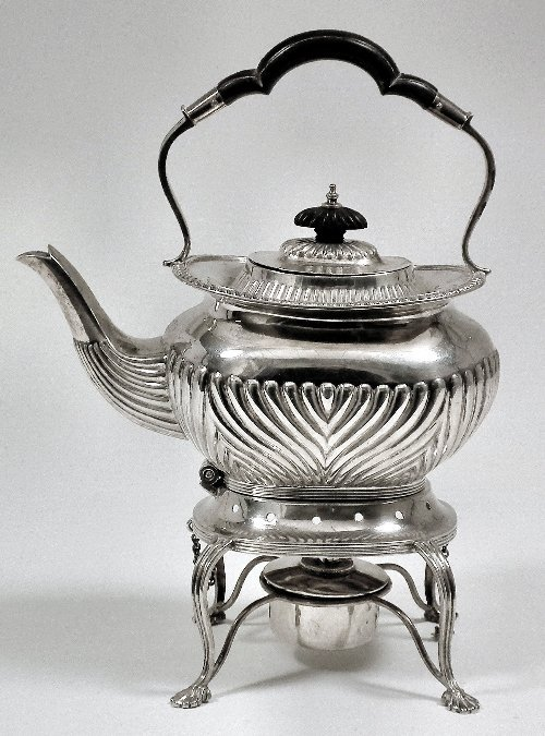 7: A Victorian silver tea kettle and stand, the tea ket