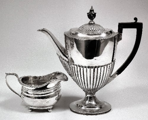 8: A George V silver oval part reeded coffee pot with e