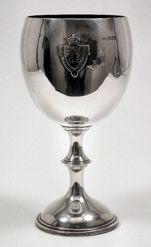 9: A Victorian silver cup, the plain bowl cast with cre