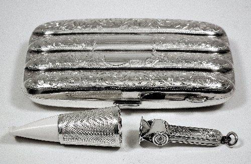 11: An Edward VII silver rectangular four division ciga