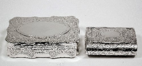 12: A Victorian silver rectangular snuff box of shaped