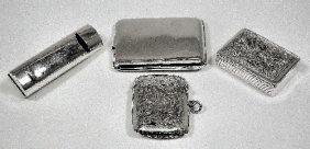 13: A George V silver combined whistle and vesta case w