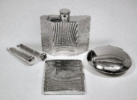 A George VI Silver Spirit Flask With Curved And Ang