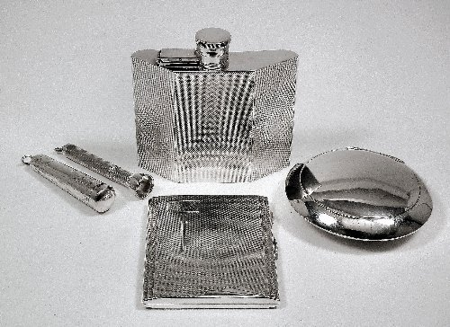 14: A George VI silver spirit flask with curved and ang