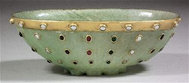 148 An Indian green hardstone and gold coloured metal