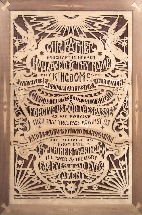 a wood fretwork panel of the lord u0027s prayer within
