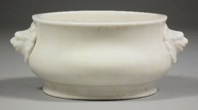 665: A Chinese white glazed porcelain two-handled low c