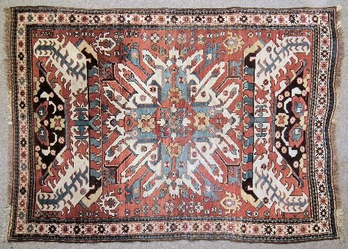 977: An Antique Caucasian rug woven in primary colours