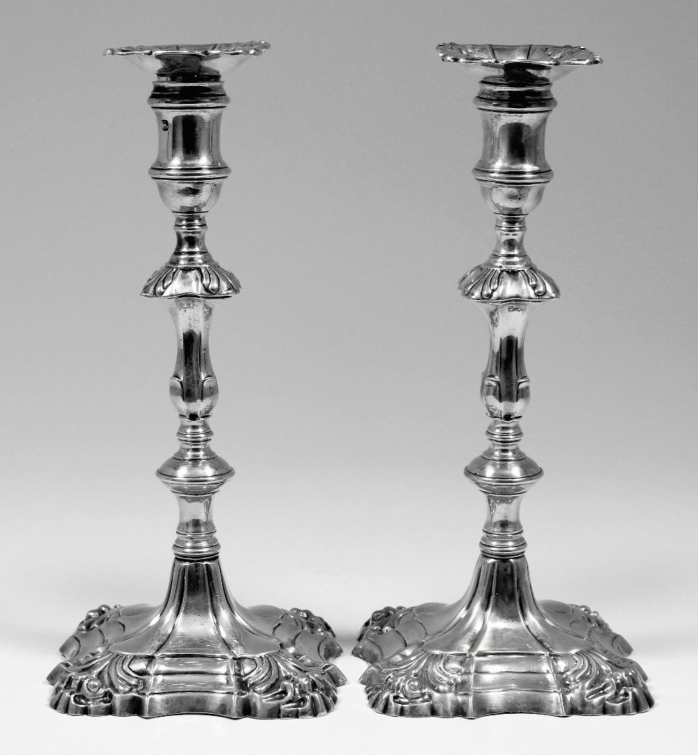A pair of George II  cast silver candlesticks with shel