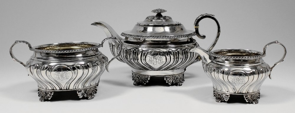 A George III and Victorian matched silver three piece t