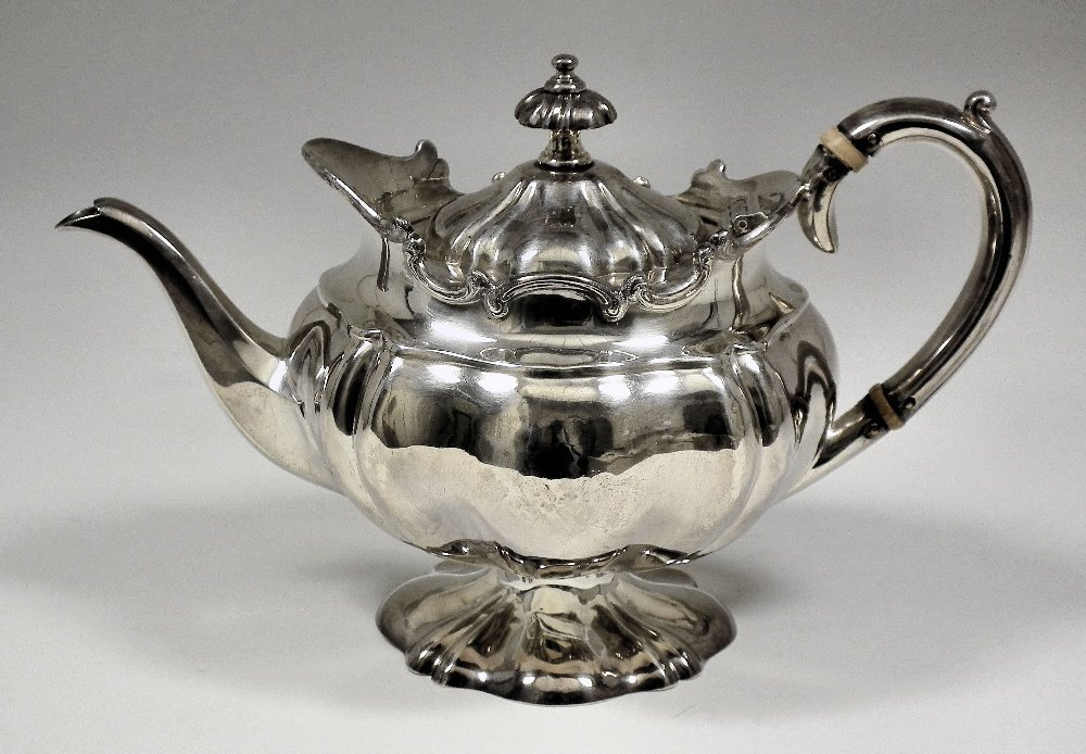 A late Victorian bachelor's silver teapot of circular b