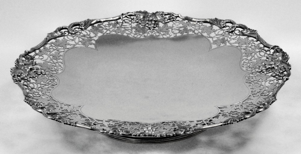 A George V silver circular tazza, the shaped and pierce