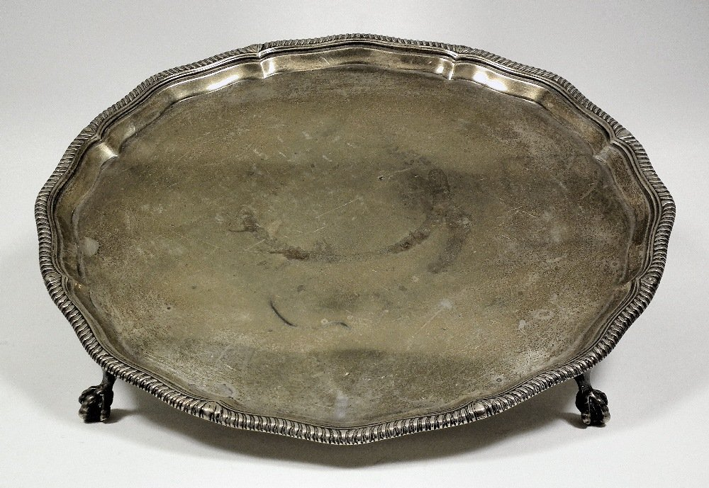 A George VI silver circular salver, the shaped rim with