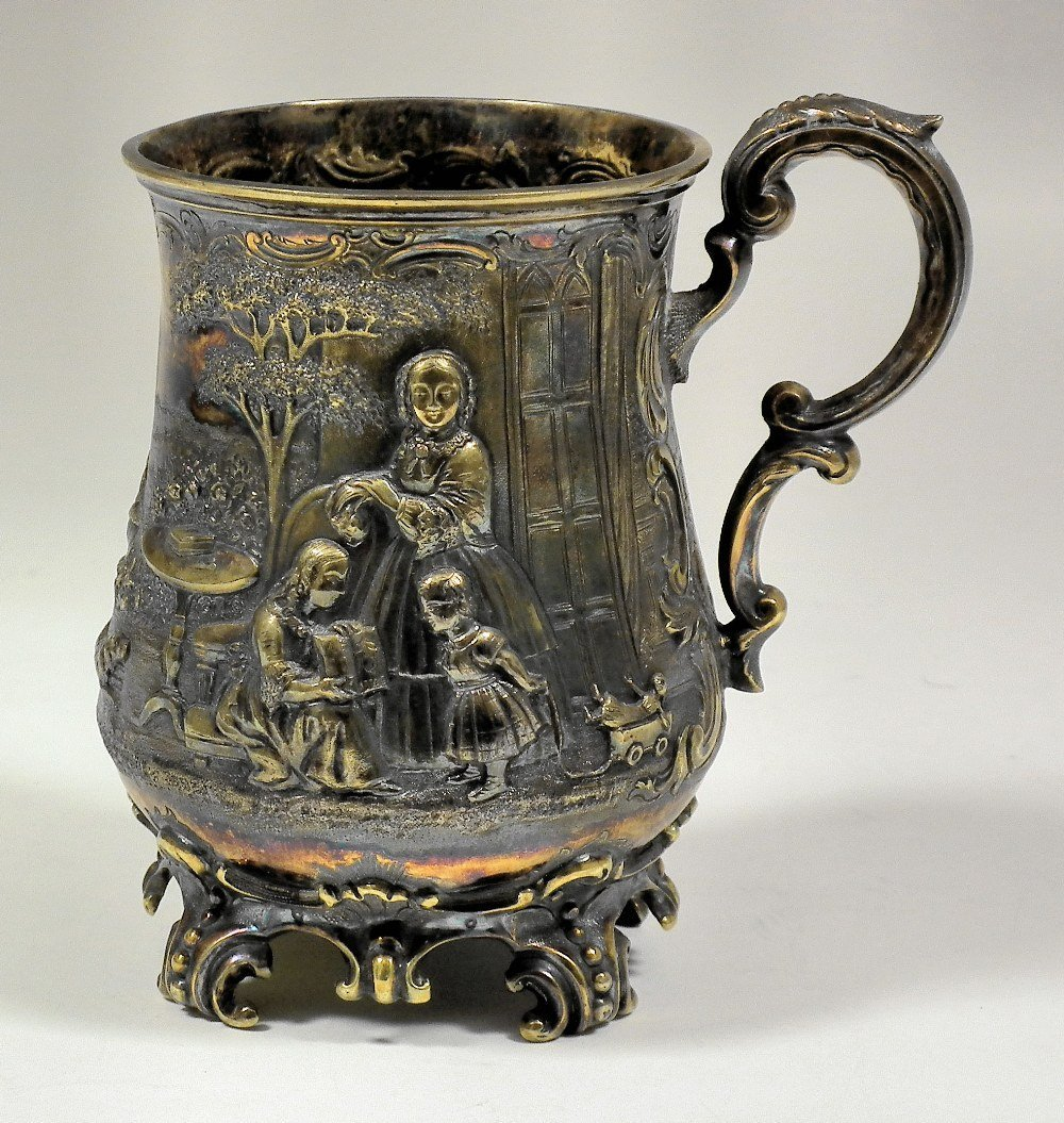 A Victorian silver baluster shaped tankard embossed wit