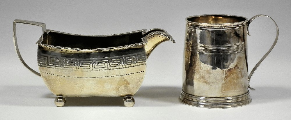 A George III silver christening mug of tapered form wit