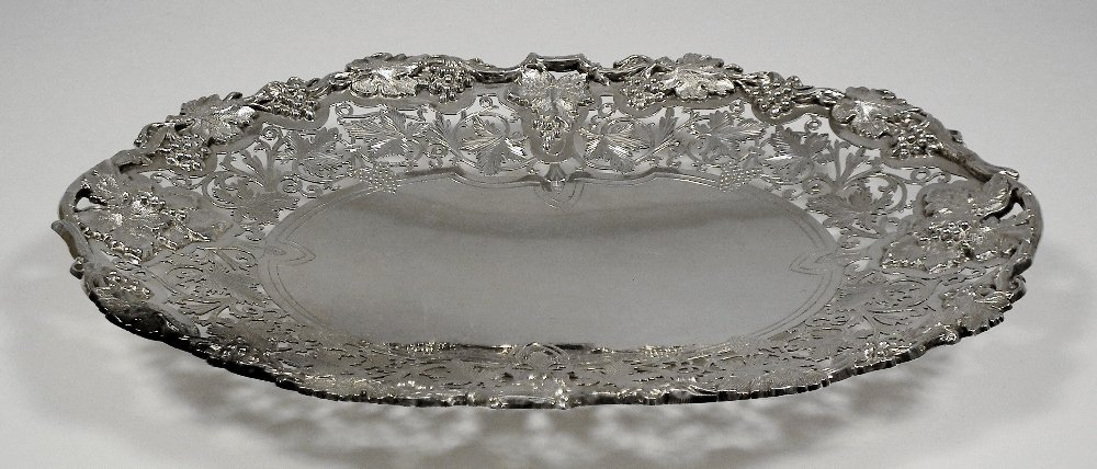 An Edward VII silver oval fruit dish, the rim cast with