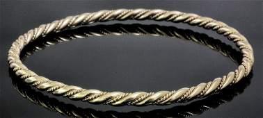 A modern 9ct gold rope twist pattern stiff bangle, inne