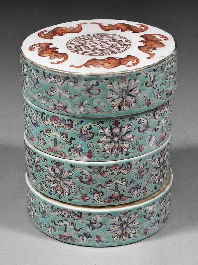 """A Chinese porcelain """"Famille Rose"""" cylindrical four-tie"""