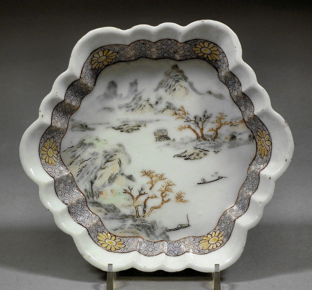 A Chinese porcelain Famille Rose hexagonal teapot stand