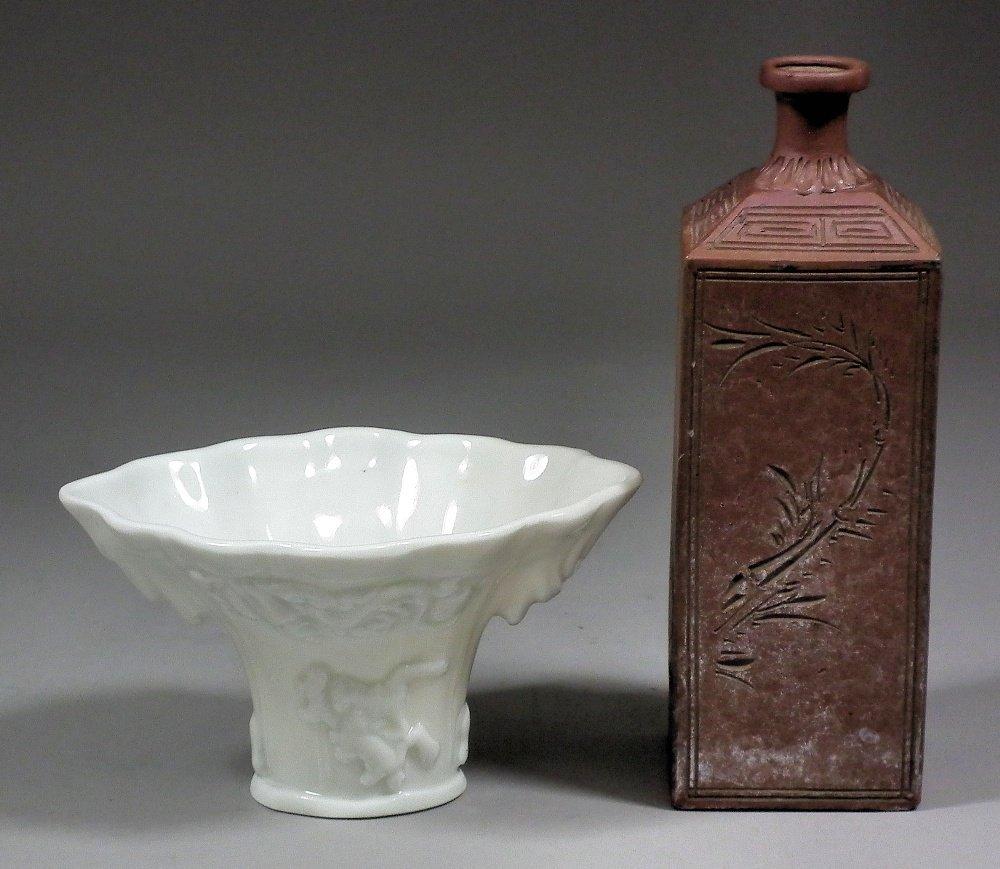 A Chinese porcelain blanc-de-chine libation cup, moulde