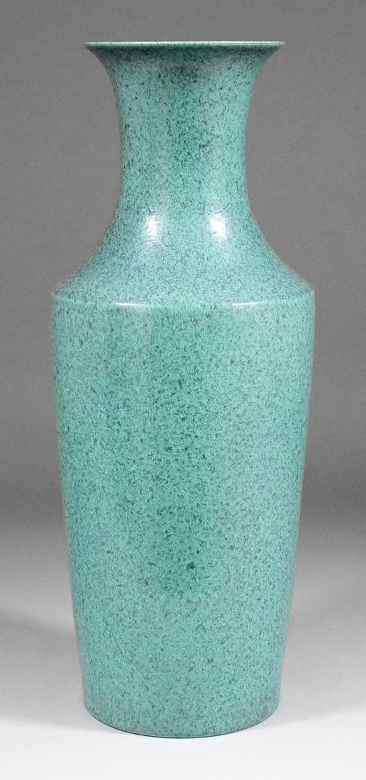 A Chinese porcelain vase with flared neck and mottled t