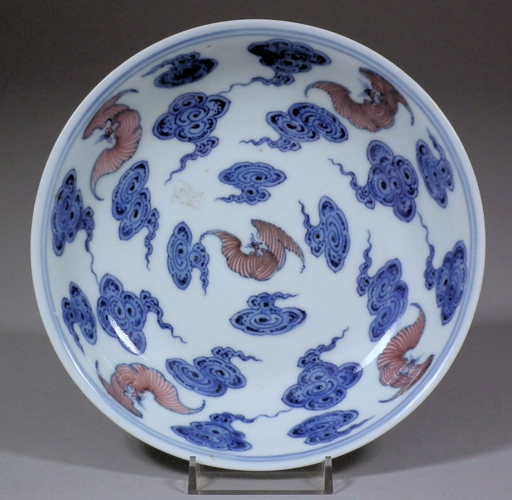 A Chinese porcelain saucer shaped dish, decorated in bl
