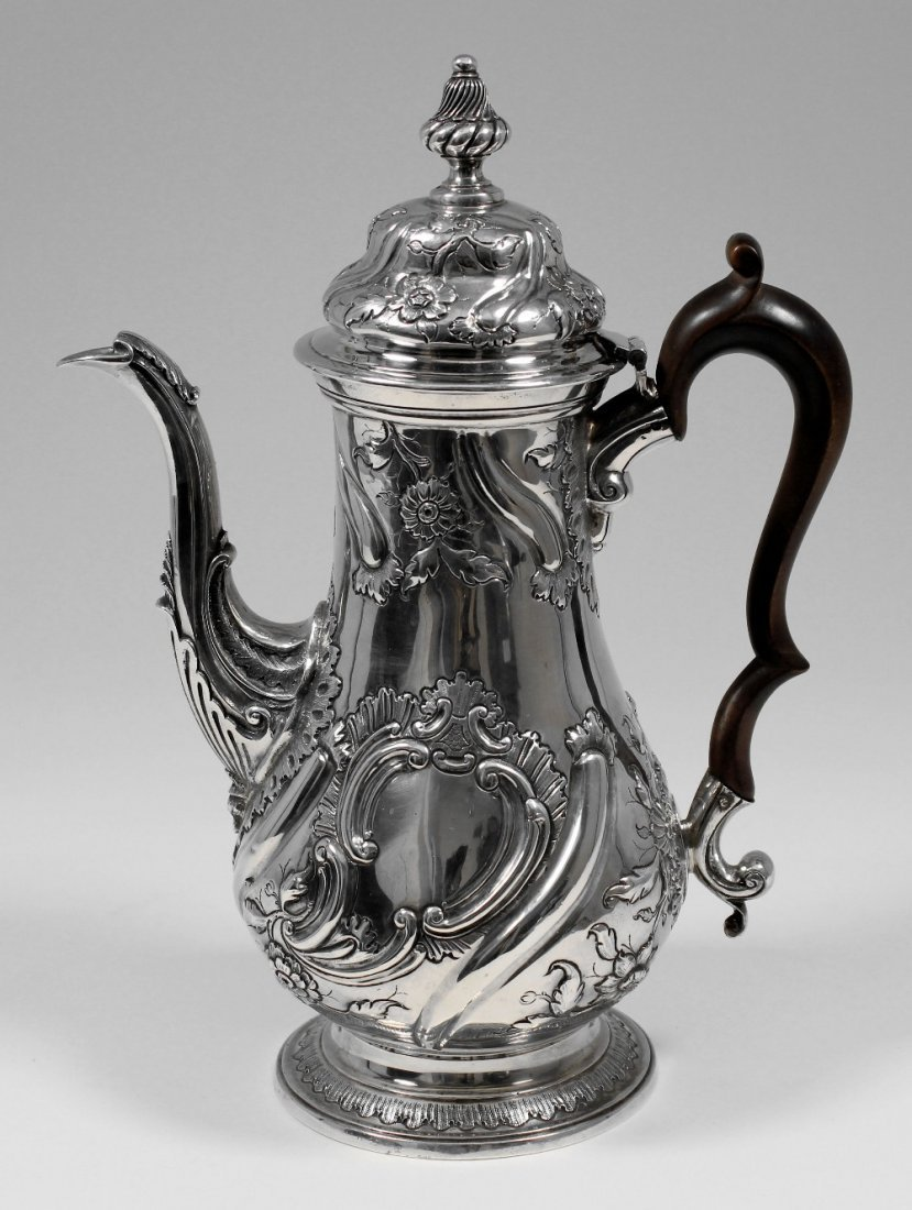 A George II silver baluster shaped coffee pot of rococo