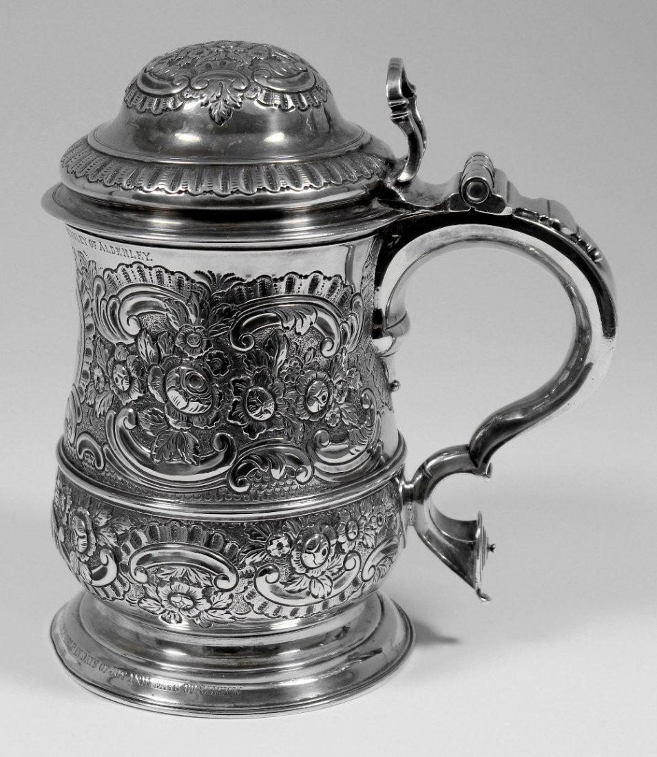 A George II silver baluster shaped lidded tankard with