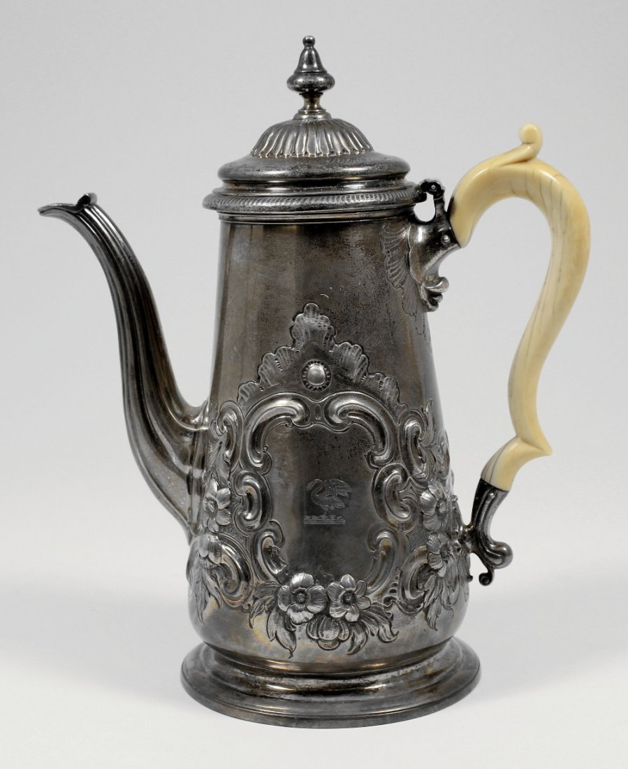 A William IV silver coffee pot, the tapered body emboss
