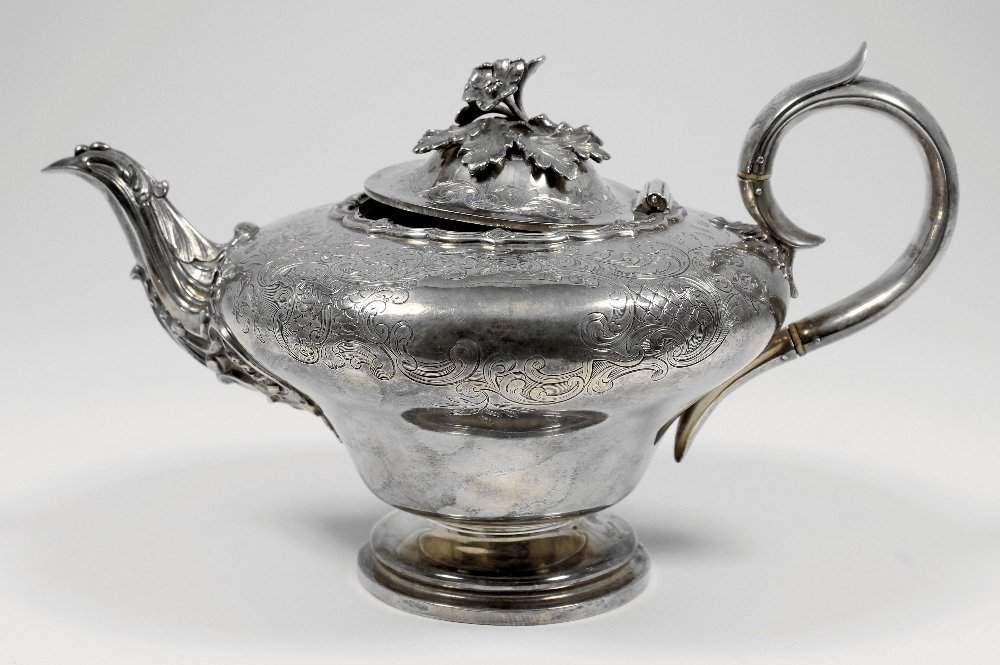 A Victorian silver teapot of bombe shape with C-scroll