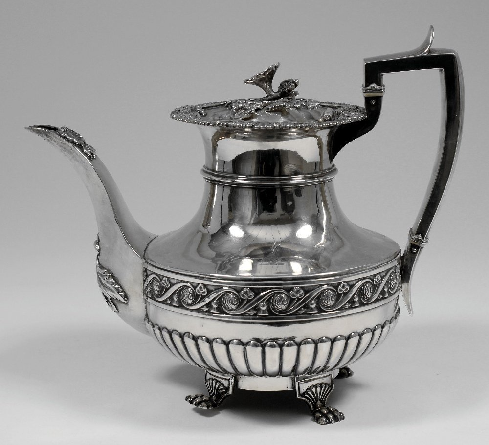 A William IV silver teapot with part reeded bulbous bod