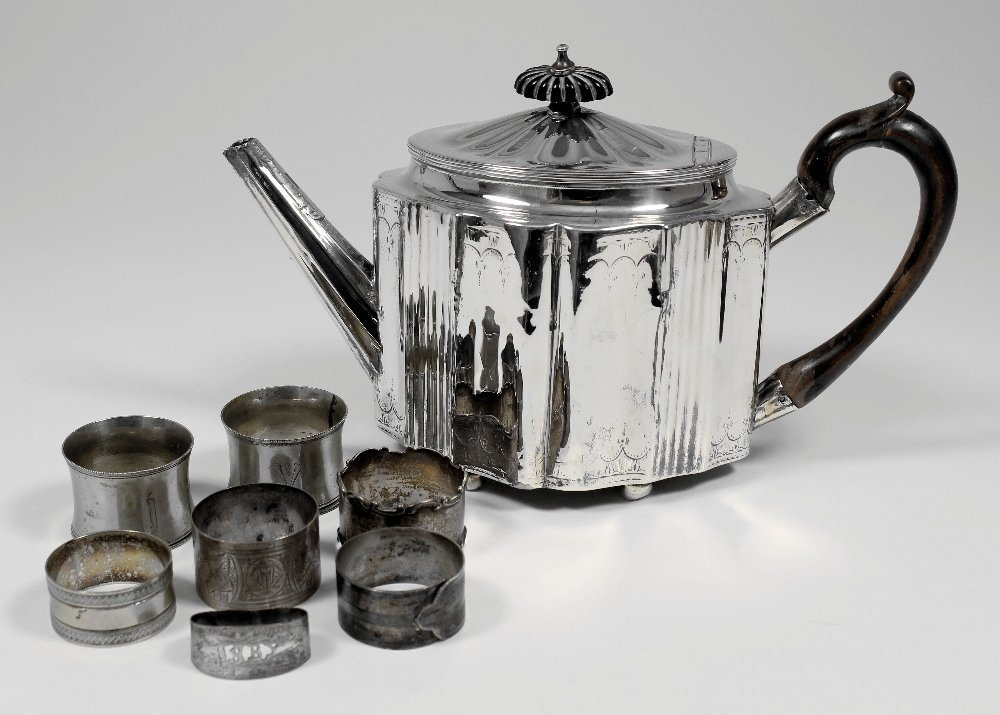 A George III silver oval teapot with wooden C-scroll ha