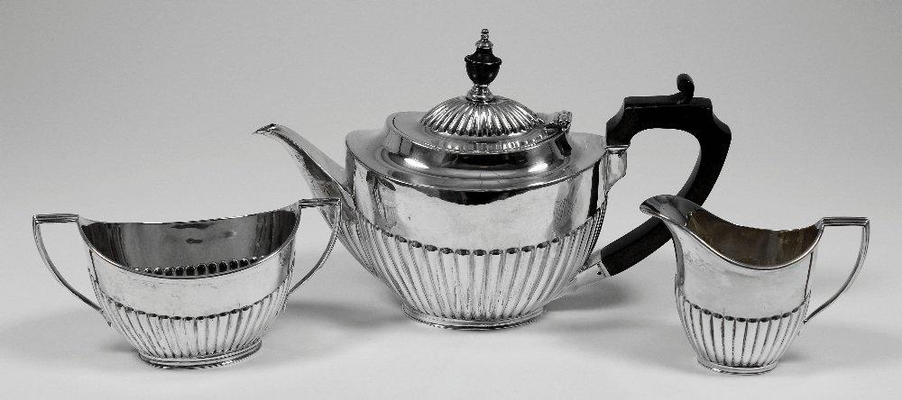 A George V silver oval three piece tea service with par