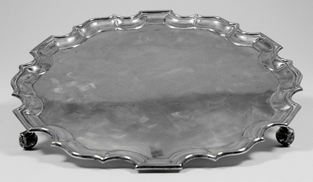 A George IV silver salver with shaped piecrust rim and