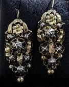 A pair of early Victorian gold and silvery coloured met