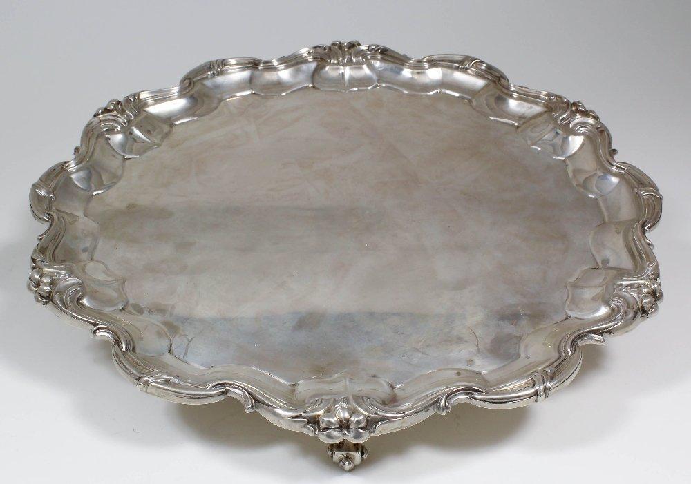 An Edward VII silver circular salver, the shaped and mo