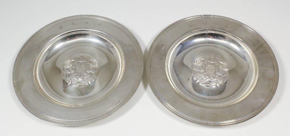 """A pair of Elizabeth II silver circular """"Armada"""" dishes"""