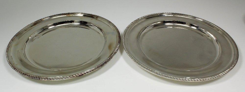 A pair of Elizabeth II silver circular plates with gadr